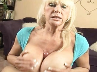 tanned blond momma with huge hooters doing titjob