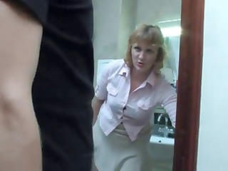 grown-up lady gets a piss on the toilet and