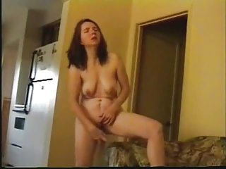 older  woman masturbate standing inside living