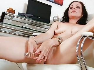 ebony haired woman bangs her glass vibrator