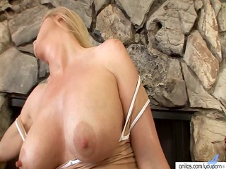 naughty woman lotions up to masturbate