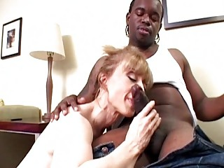 classy pale lady slurps on raging dark boner