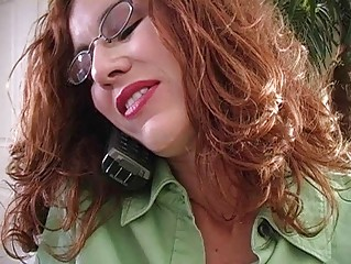 slutty redhaired momma with glasses gives dick
