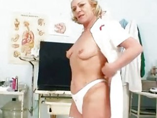 bleached elderly medic making use of  gyno kitty