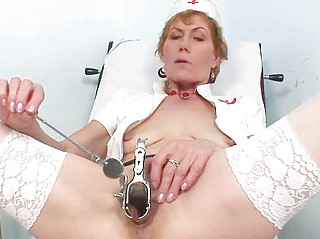 elderly woman self exam on gynochair with speculum