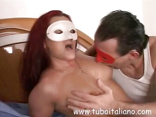 british ginger wife inside a mask blows and