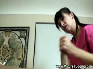 cougar masseuse gives a horny tugjob