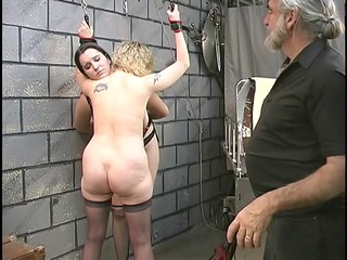 two pretty basement bdsm lesbians make out and