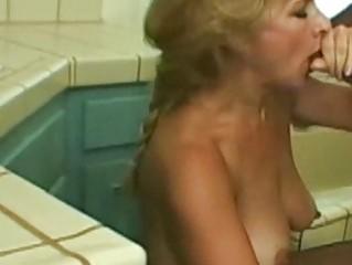super older  blond enjoys brown penis