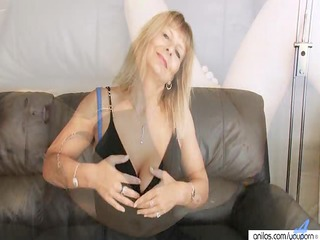 naughty cougar fisting her hairy pussy